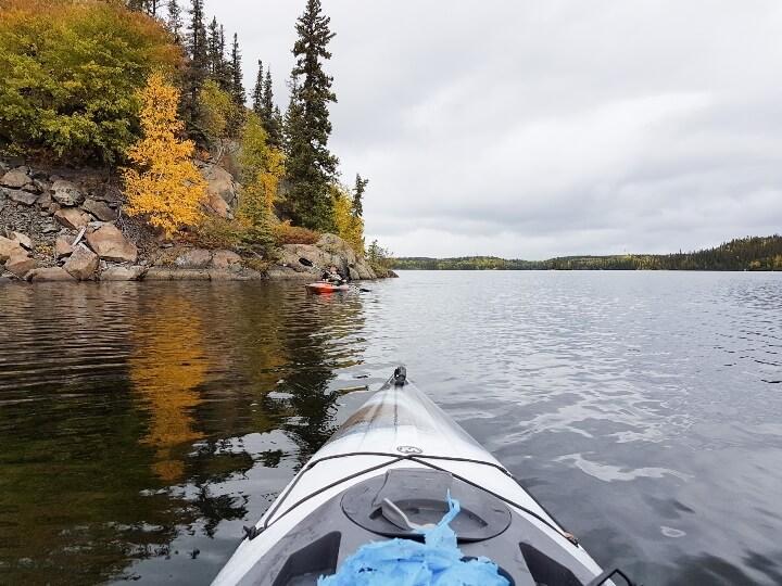 Kayaking on lake while picking up trash